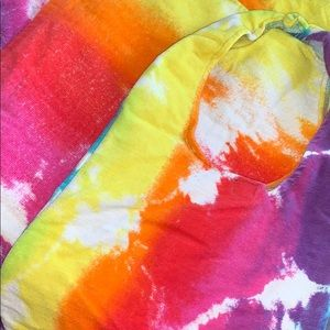 multi-colored towel with matching bag